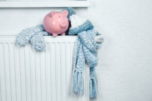 piggy bank and scarf on a radiator